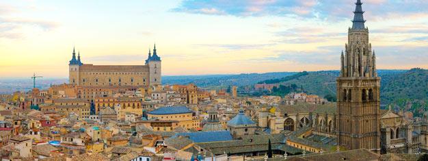 Passeio completo de um dia a Toledo, com saída de Madrid. Inclui transporte, degustação de vinho em Bargas e visita a mesquita, igreja e sinagoga medievais. Reserve online!