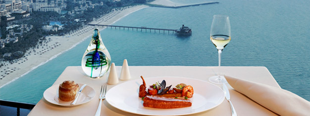 Enjoy a great lunch and the spectacular view over the Arabian Gulf from the iconic building Burj Al Arab in Dubai. Transfer is included. Book online!