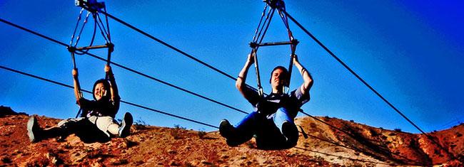 Sie wollen eine Zip Line Seilrutsche ausprobieren? Dann kommen Sie mit auf ein spannendes Abenteuer mitFlightlinez Bootleg Canyon außerhalb Las Vegas! Kaufen Sie Ihre Tickets online!