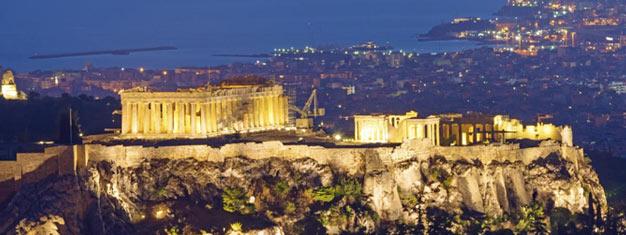 Disfruta una noche festiva en Plaka en Atenas! Ve el Acrópolis iluminado de noche y disfruta una cena tradicional griega. Reserva tu tour en línea!