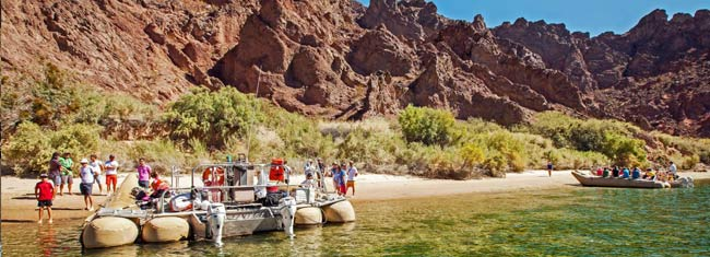 Go river rafting and experience the beautiful waterfalls, hot springs, go for a cooling swim in the Colorado River, see the wildlife and more. Book now!