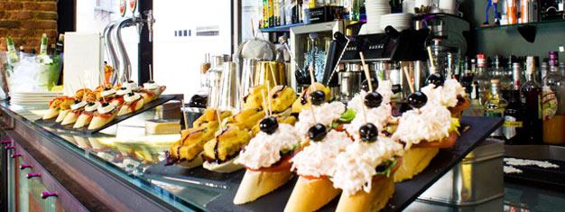 Få en smak av Madrid på en historisk promenad med kunnig lokal guide. Smaka på 10 olika typer av tapas. Boka dina biljetter online! Tapas & Historia i Madrid!